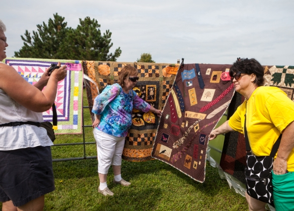 Yvonne Wilson, a member of the Mothers Guild of Boys Town holds a quild  quilt for a picture.