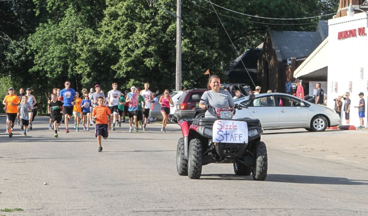 Joy Lauritsen leads the pack at the start of the Summer Sizzle 5 k.