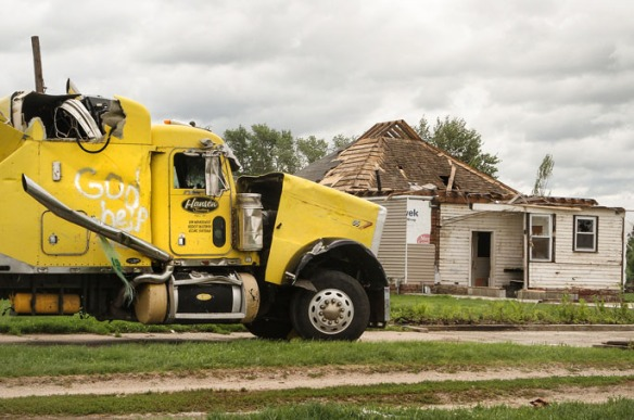 """The side of the damaged semi-tractor  reads  God Help Us."""""""
