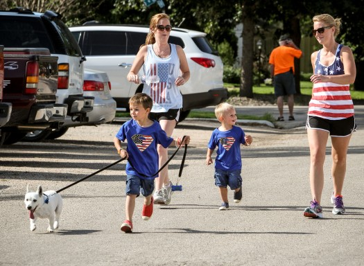 Haydn McClanahan walks Wrigey in the 5k run as Ali and Eli McClanah,and Mallory Paulsen follow.