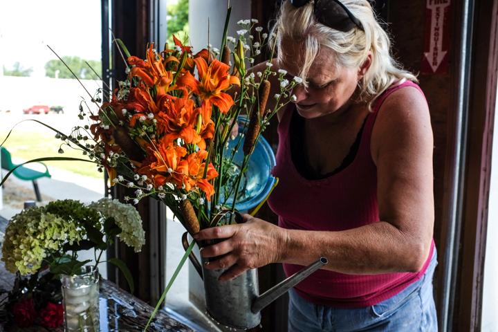 Betty Lambert assembles flower arrangement.