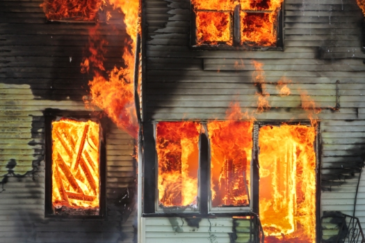 Fire engulfs the back entrance to 100 year old farm house.