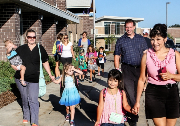Steve and Kim Casto accompany kindergartner Katie to Deerfield on Monday.  Katie would have liked to have taken the shuttle, but Steve will be taking Katie to school.  Katie is excited to attend Deerfield because some of her friends attend Deerfield.