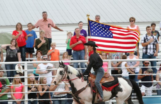 Horse rider displays  the colors during playaine of Star Spangled Banner.