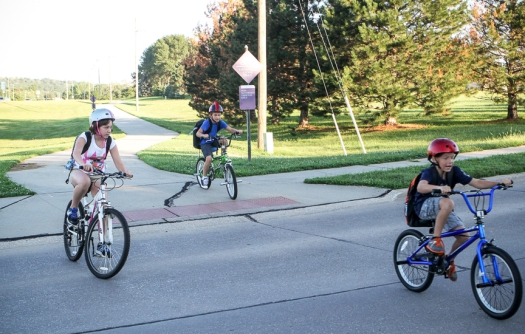 Students make their way along the Deerfield trail to Arbor Park on the first day of school.