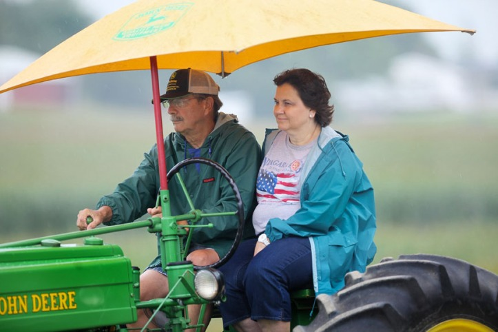 Denny and Norma Baehr stay dry under canopy during the morning tractor ride.