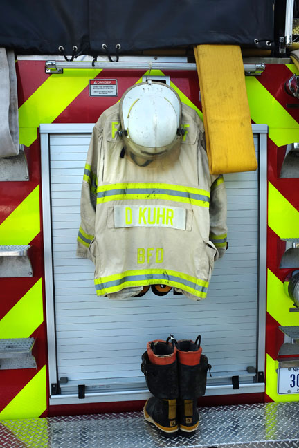 Don Kuhr's helmet, coat and boots hang at the ready on the back of a Blair fire unit.
