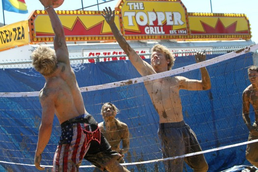 Drew Harsin, and team mates compete in mud volleyball tournament