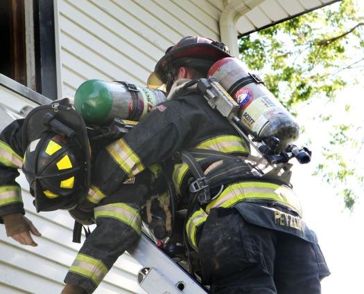 Blair firefighter Heath Ryzlik demonstates a feiman carry with the help of fellow Blair firefighter Joe Leonard prior to the practice burn.