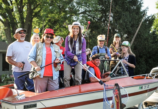 "Fort Calhoun teachers dressed in fishing attire find a promising ""school"" of students Thursday morning."