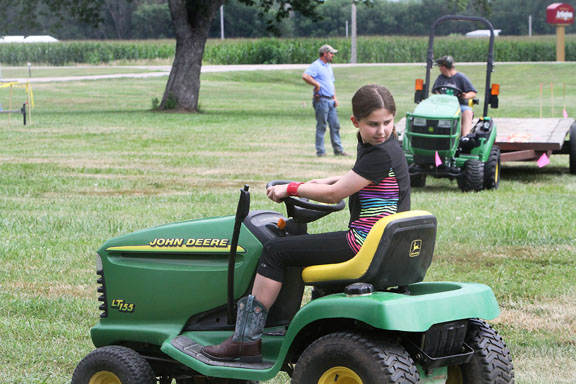 Jenna Murch Shaffer backs up her tractor in tractor driving contest.