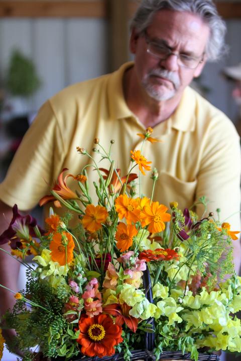 Kent Stork judges cut flower bouquet.
