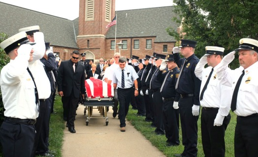 An honor guard made up of fire fighters from across the county deliver a final salute following the funeral service for Don Kuhr.