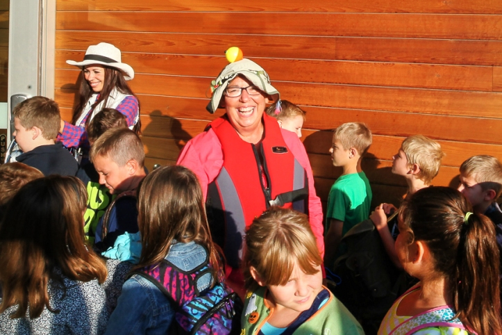 Marti Leishman greets students as they enter the building on Thursday.