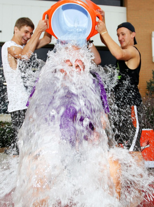 Vice Principal Mark Gutshow gets soaked with  one of three buckets of ice and water.