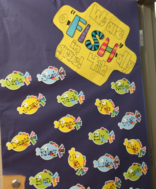 "Signs on bulletin boards, walls and doors carry out the fishing -and ""hooked on learning theme. """