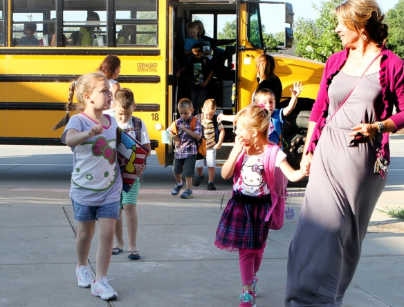 West Kindergarten teacher Peggy Rutcosky accompanied students riding the shuttle bus to Deerfield on Monday, the first day of school.  West classes have been temporarily moved to Deerfield and North schools while repairs due to the hail storm are completed.