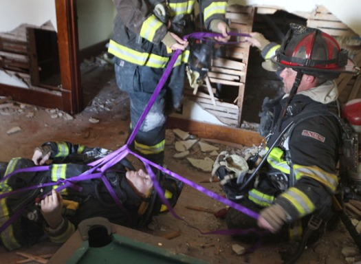 Blair firefighter Joe Leonard portrays a hurt fireman as Blair firefighers  riley Schonefilde and Heath Reyzlik domonstrate how to use webbing to pull Leonard to safety.