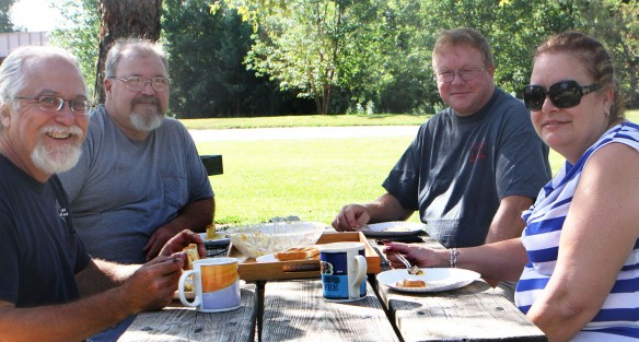 Barry Baldwin, Dan Griffith, Tim Halbauer and Tammy Baldwin share breakfast at Bob Hardy RV park on Sunday morning.