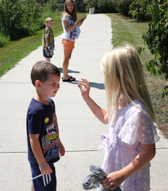 Kathryn Picton show s Brayden Davis a small seed she collected during a scavenger hunt at Black Elk-Neihardt Park