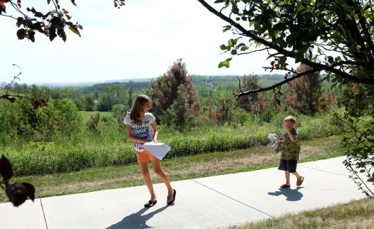 Tamry Putnam and Paul Owen look for colored leaves and grass during a scavenger hunt at Black Elk-Neihardt park.