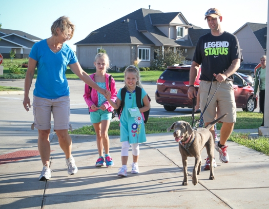 Brenda  and Ryan  Schroeter and dog Mae accompany  Brooklyn and  Ryleigh Schroeter to school at Deerfield on Monday morning.