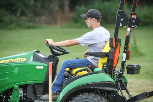 Jake Theisen, tractor driving