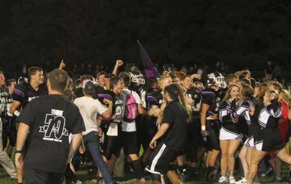Team members and fans celebrate big win.