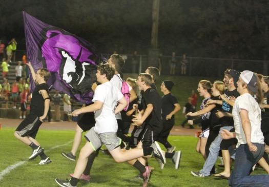 Fans take the field to celebrate big win.