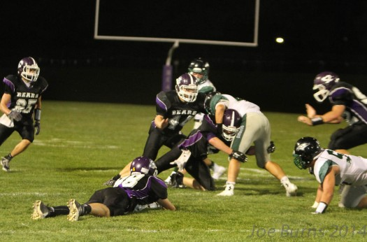 Skutt quarterback brought down behind line of scrimmage.