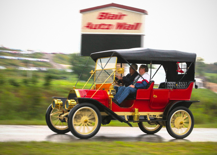 Tom Ruggles and passenger Gary Turley in 1910 EMF touring car at highway 30 roundabout.