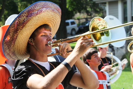 Trombone player Auggy Namath marches in homecoming parade.