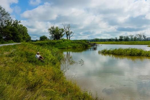 Omahan Abraham Lincoln waits for a fish to bite at Bullhead pond at DeSoto NWR