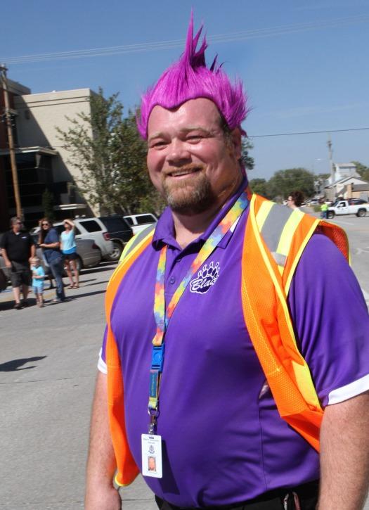 Blair Otte Middle School Principal Chris Stogdill sports purple hair.