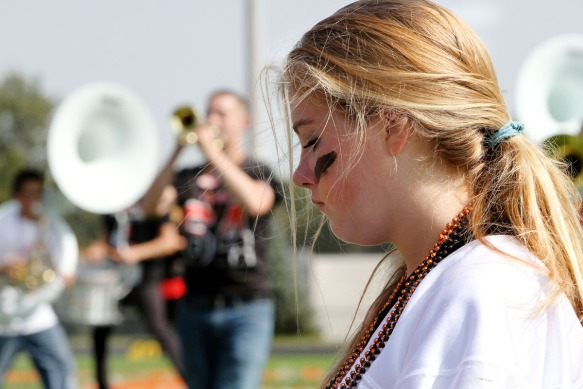 Cassie King plays bells during band show performance.