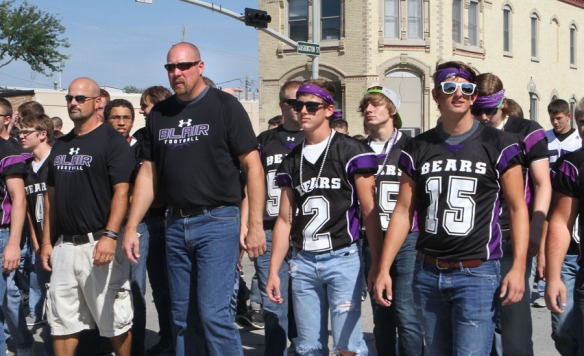 Blair football team walking  in homecoming  parade.