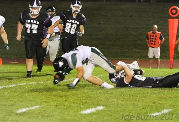Zane Bozwell sacks Skutt quarterback.