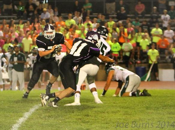 Connor Yost makes brings down quarterback.