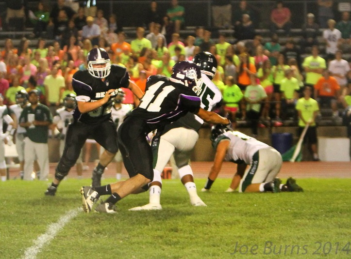 Connor Yost makes brings down quarterback.