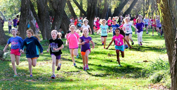 Fourth Grade girls run in the annual Turkey Trot at Arobr Park.   Over 200 students participated.