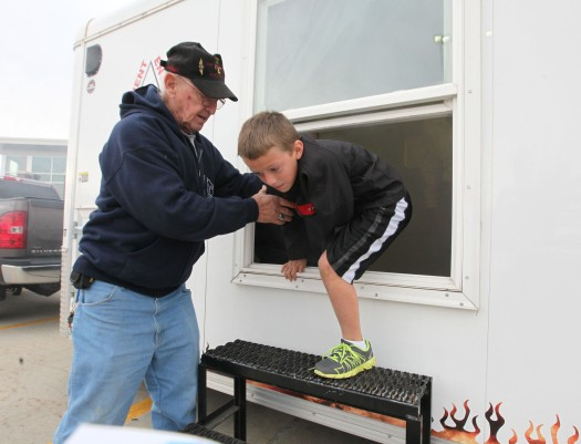 Bob Tichota helps Ethan Lundgren exit from a window in the smoke trailer.