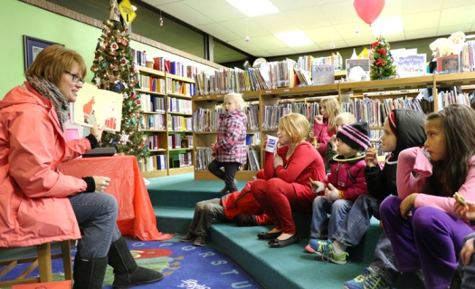 Becky Lacey reads to children at the Blair Library