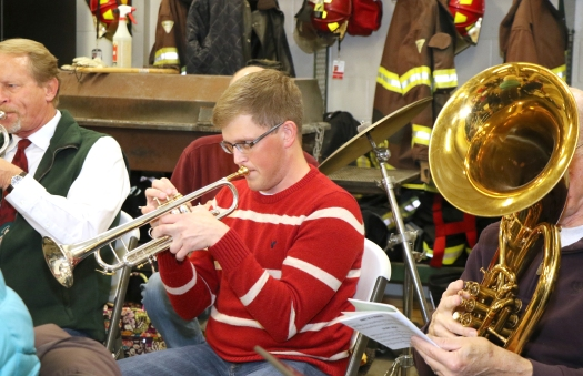 Ryan Beasley plays trumpet with the Blair Area Community Band at the Sourh Fire Hall thursday evening.