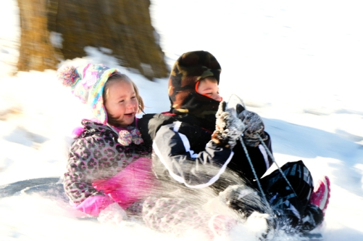 Braley Duckworth and Beckett Scott go for thrills and chills on the slope at Ralph Steyer Park Sunday afternoon.