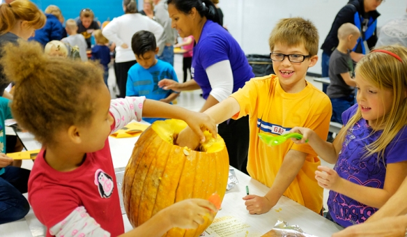 South firs grade students Kids clean out pumpkin.