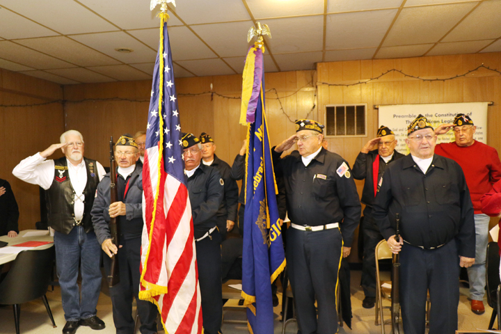 American Legion-Jackson Peck Post 274 color guard salutes during singing of the Star Spangled Banner.