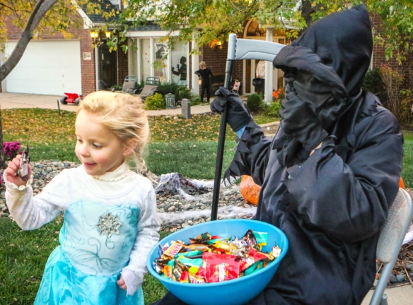 Nicole Dondelinger-  is delighted with treat from Jakob Andersen dressed as the  as grim reaper