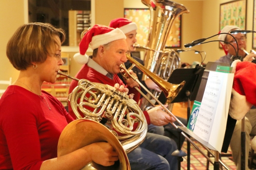 Downtown Brass players from left, Jane Jaworski-Andersen, (Horn)  Brian Lund (trombone).Josh Lund (tuba) and Marty Rump (trumpet) play Christmas themed music at the Washington Street Pre-School Thursday evening.