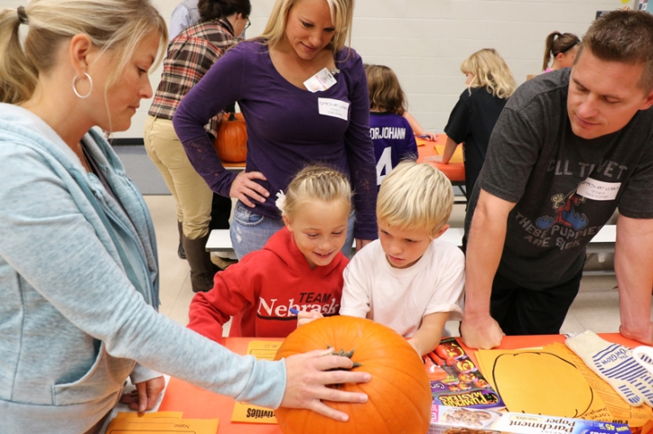 North second grade students  draw a face on their pumpkin that will be carved int a jackolantern.