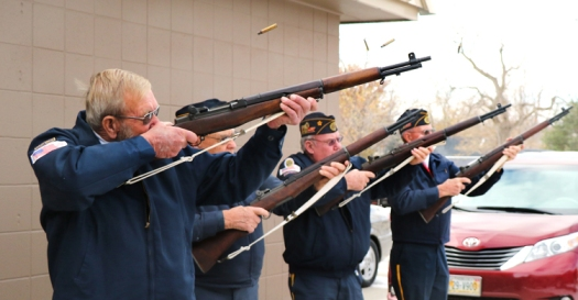 American Legion Post 274 firing squad fires the Veterans Day rifle salute